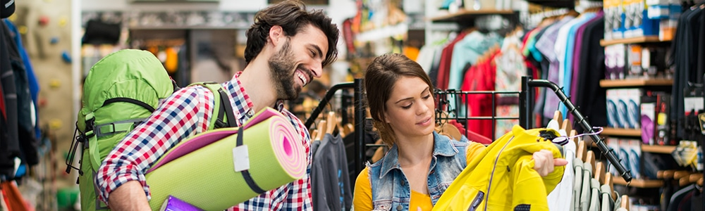 Man and woman shopping in a sports shop - symbolises the process behind where EDI for Sport 2000 comes into play.