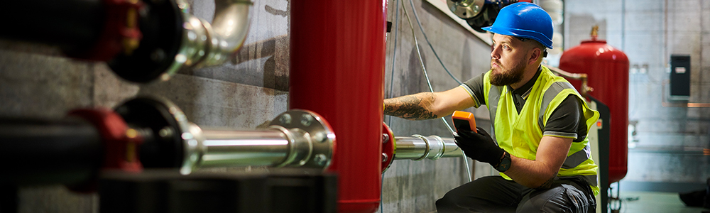 Technician checks boiler - efficient EDI processes at Austria Email